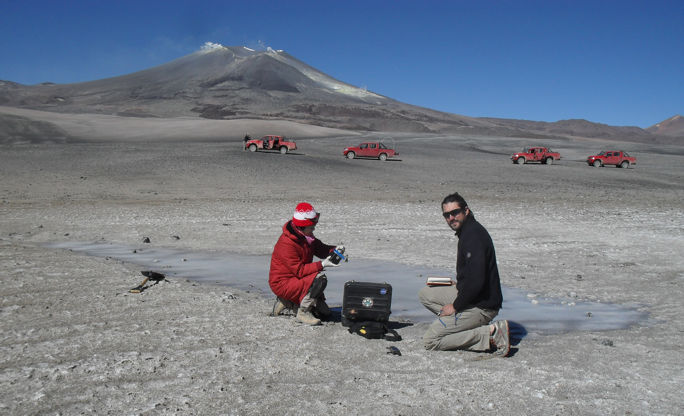 Prof. Alian Wang and Dr. Pablo Sobron (Canadian Space Agency) are deploying two WashUWUSTL-built water infrared (WIR) and Bio-UV-Fluorescence (BUF) sensors onto the salty ice at Laguna de Azufera (Lake of Sulfur) in Atacama, Chile.