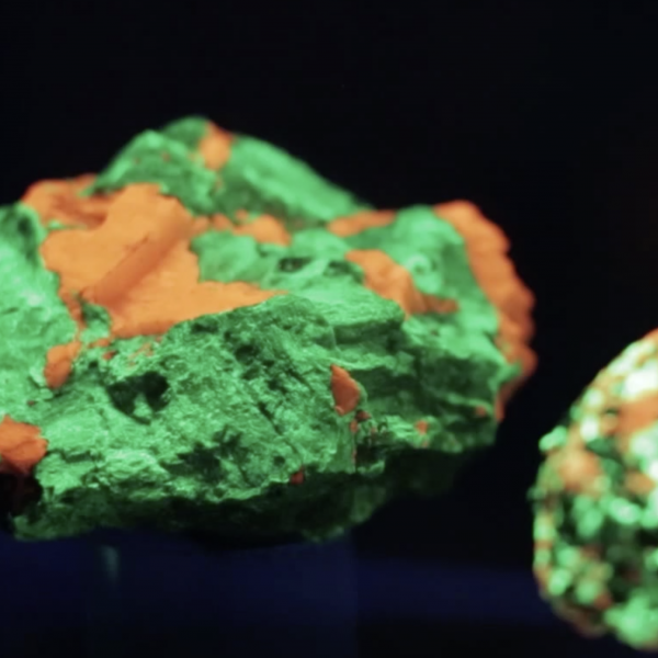 glowing green and orange rocks