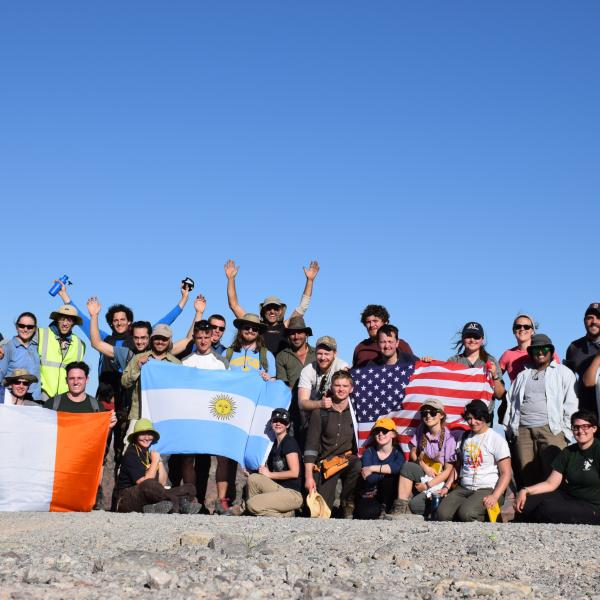 Students with flags at huaco